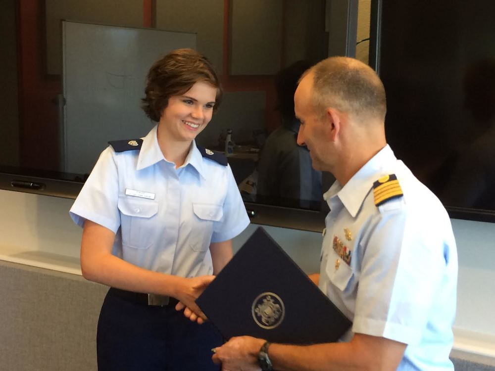AUP's Caroline Howard, who is the deputy unit leader for Unit William and Mary, is presented with a commendation for her service during her summer internship at Coast Guard Headquarters. (Photo courtesy of Lt. Commander Molly Waters)