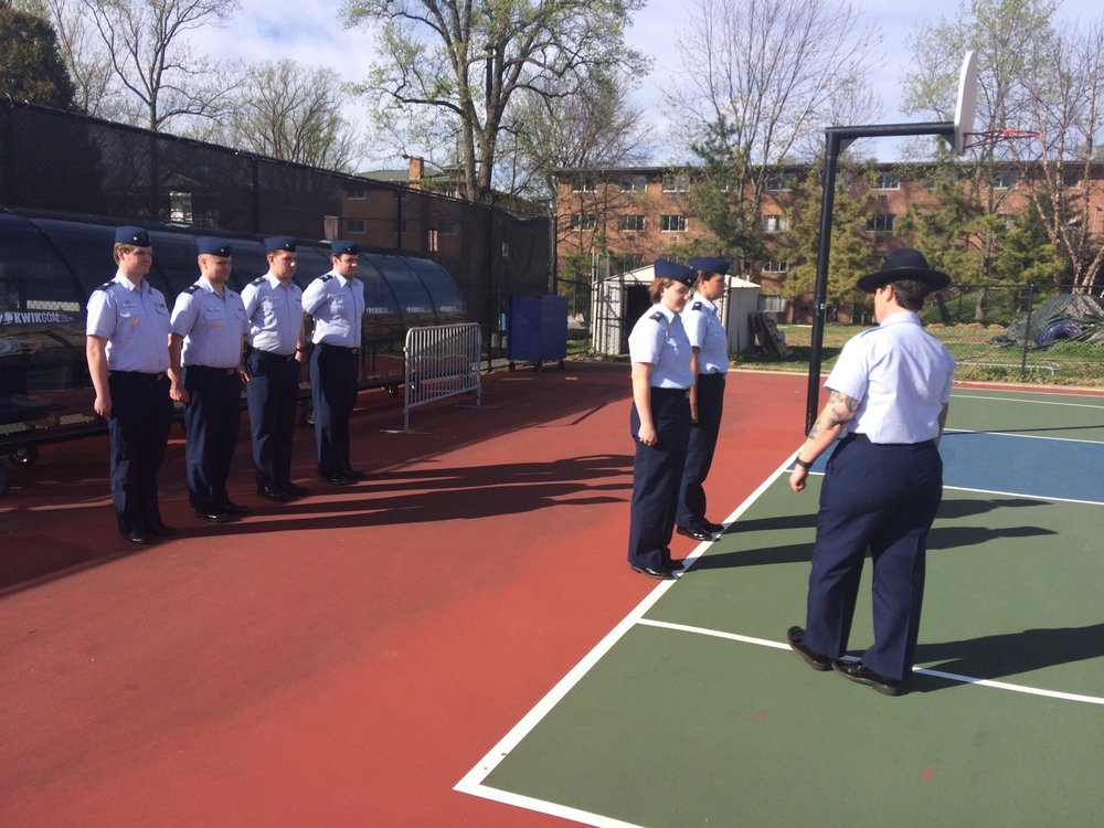 Members of the United States Coast Guard Auxiliary University Program receive drill from Company Commander MKC Reid at American University.