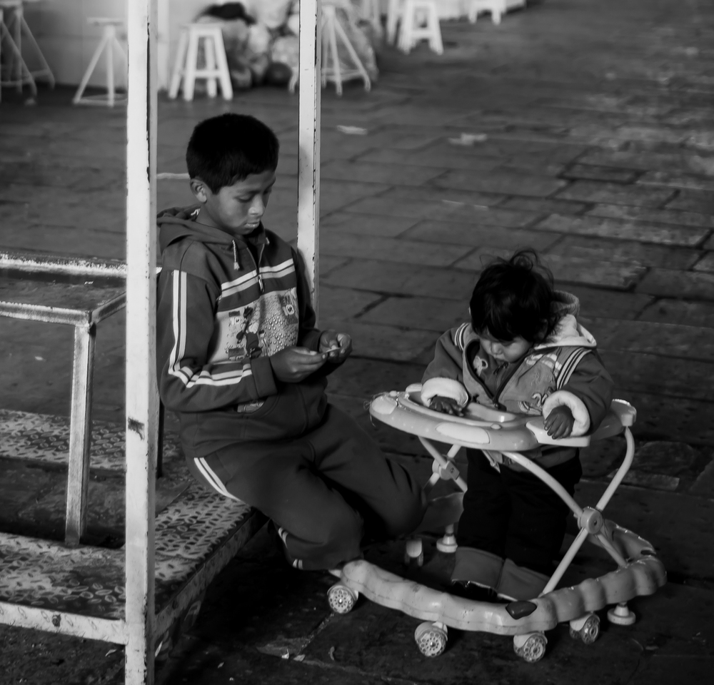 Taken in the Mercado Central. These children find a quiet corner in the daily market, an institution of the city.