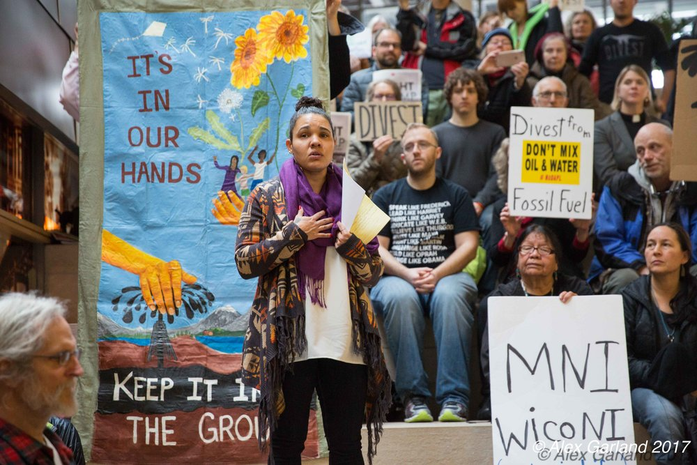 #NODAPl organizer and muckelshoot tribal member, rachel heaton, talking at launch of seattle divest, feb 15th 2017
