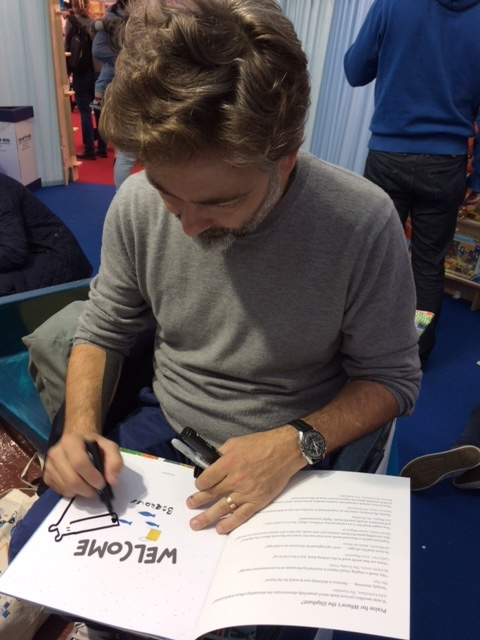 Barroux signing in the boat at the Cheltenham festival.