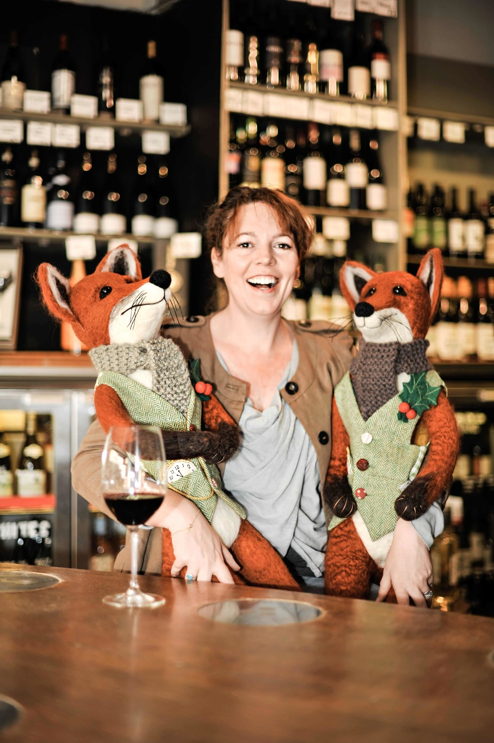 Olivia Colman with two of the specially made foxes that will be auctioned off for charity