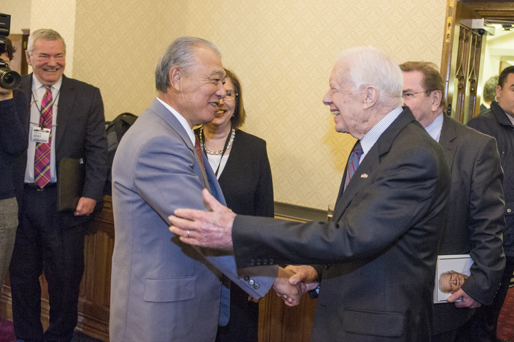 President Jimmy Carter and Mr Yohei Sasakawa greet one another at the House of Lords