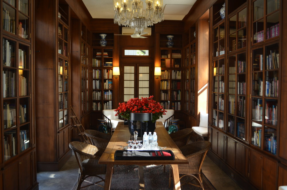 The 2000 book library at The Rachamankha stuns with Thai teak shelving, sun drenched reading nooks, and gorgeous pottery.