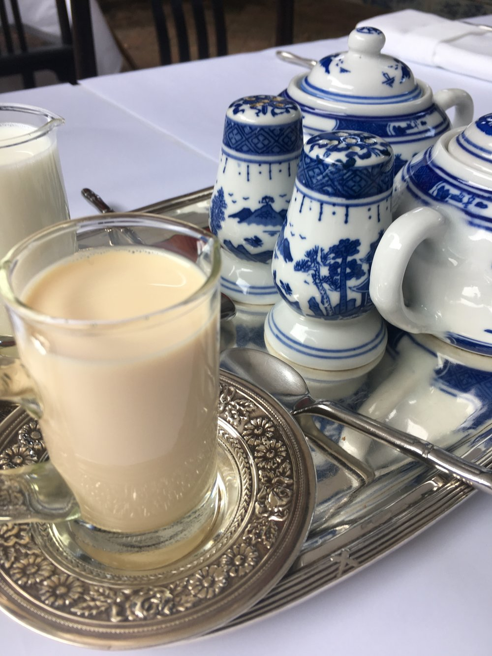 Delicate hand painted china, crisp linens, sliver serving trays from Laos, and thick cream for your rich coffee welcome you at breakfast to help jump start your day of adventure.