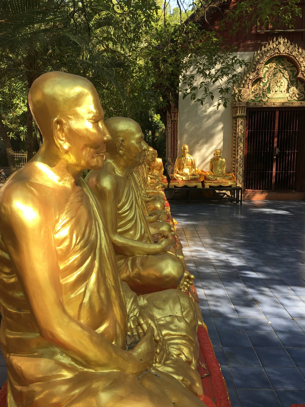Immortalized monks at the War Phra Singh Temple in Chiang Mai, Thailand