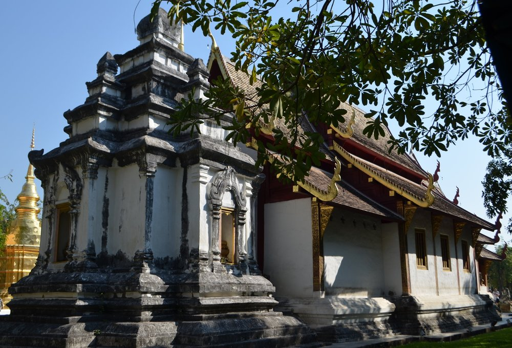 A stunning sanctuary accented with gilded serpents, stone carved lions, and lions.  Often monks will be teaching tourists about Buddhism or life on the monastery under trees or pavilions.