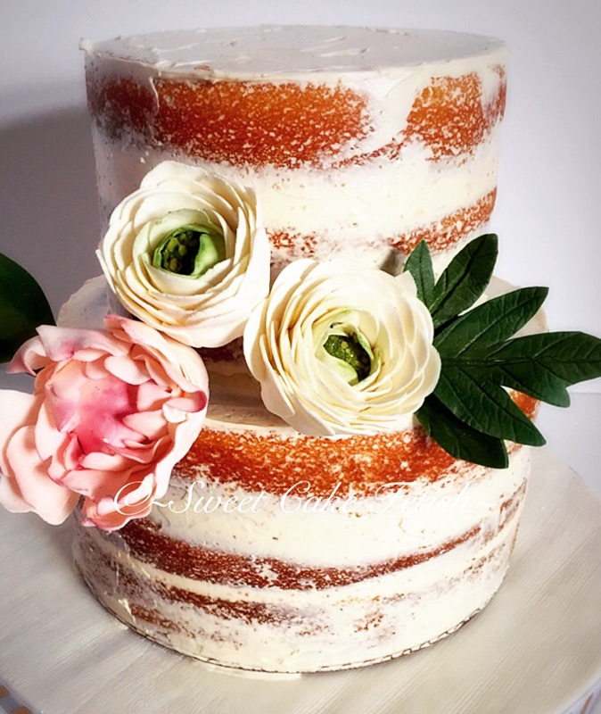 We had the pleasure in making this elegant, yet stunning naked cake for a special young ladys' 18th Birthday! Naked cakes are certainly one of our favorite cakes. The simplicity and elegance are just so organic. We adorned this cake with handmade sugar flowers chosen by the birthday girl!