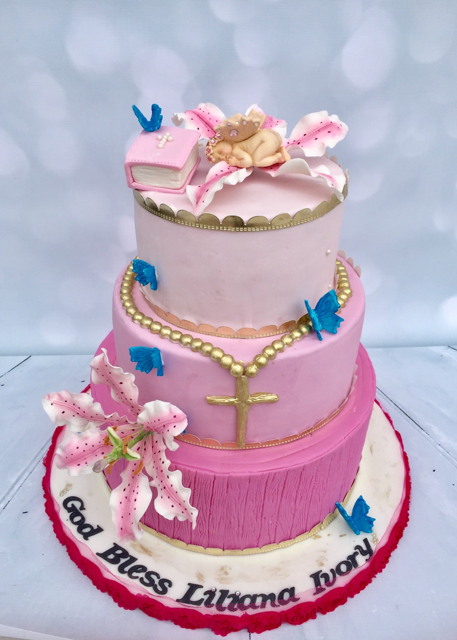 This week we had the pleasure to create a beautiful Baptism cake for baby Liliana Ivory!  The cake featured a large tiger lily sugar flower, a sleeping baby, a cascading pink ombre, a gold rosary and beautiful blue butterflies.   Congratulations and god bless!