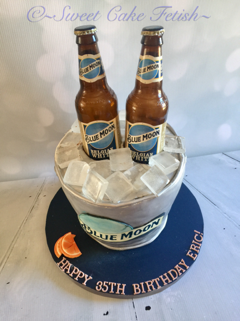 Our favorite cake of this week is the Blue Moon Themed cake! This cake was made for Eric's 35th birthday and featured beer bottles and a silver bucket! Another new and fun cake for us.  Happy 35th Birthday Eric!