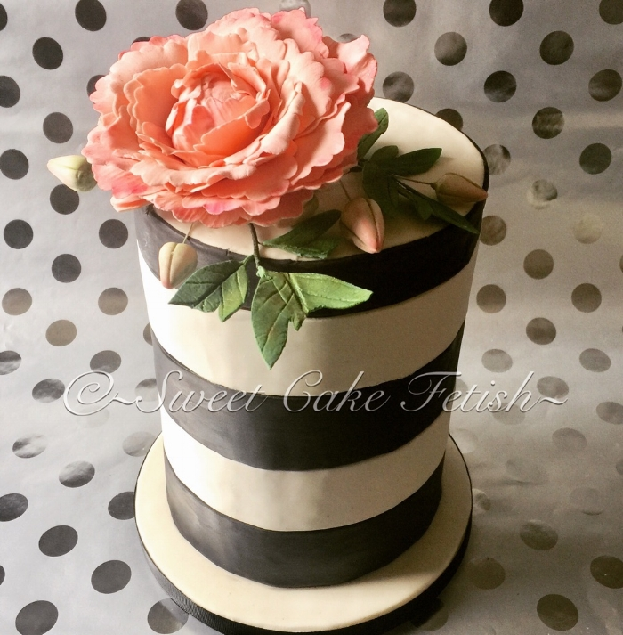 Today's cake was a stunning and simple double barrel black and white striped cake. The cake was topped off with a large pink peony and green sugar leaves.  This cake was made for one of our favorite repeat clients from Fort Lee, NJ.    Thank you again for all your support!