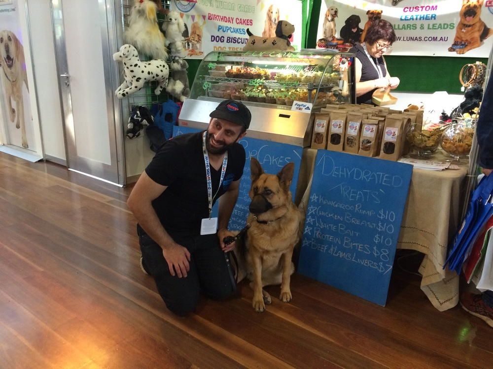Manny Capones from Luna's Cucina and Collars, with Luna the German Shepherd