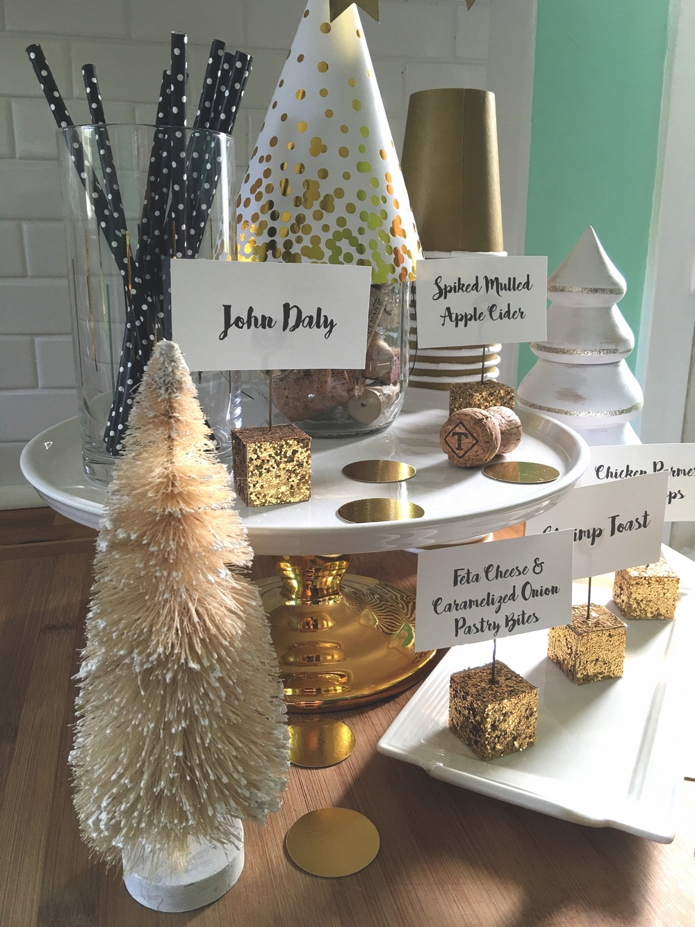 While at West Elm, I chose four wiry yellow Christmas trees with frosted edges. They were half off because it was a few days after Christmas. The Wooden, white trees with gold glitter rings were also half off, and came from Target.