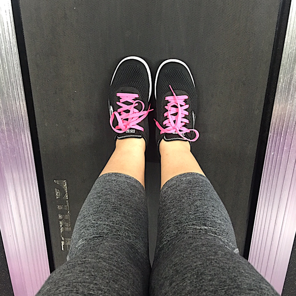 My new running shoes! They're so comfortable. The pink laces I added are a happy thought when I see them during a tough workout.