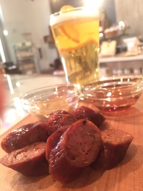 Sausage Board w/half pint beer - Grilled Salchicha de Huacho pork sausage, hits the flavour mark with garlic, cumin, annatto & aji amarillo chili paste. Side of dijon mustard and maple syrup.