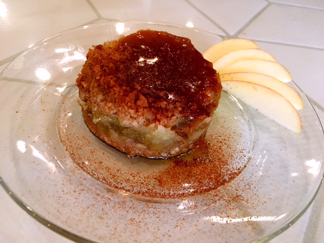 Caremal Apple Crumble Cake - warm apple crumble cake with the running caramel sauce on the top.