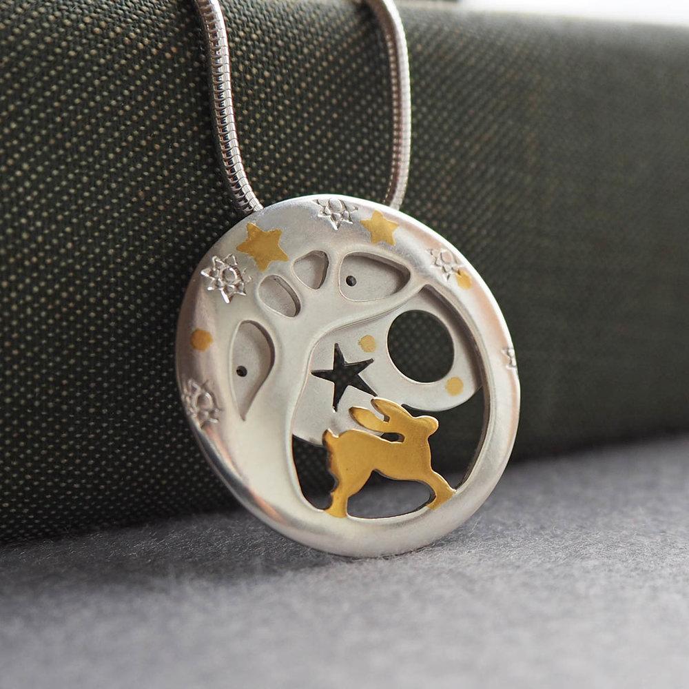 Hare pendant trees and stars.jpg