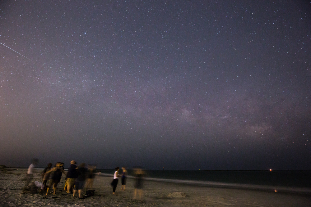 Worship on the beach under the stars in Wilmington, North Carolina.
