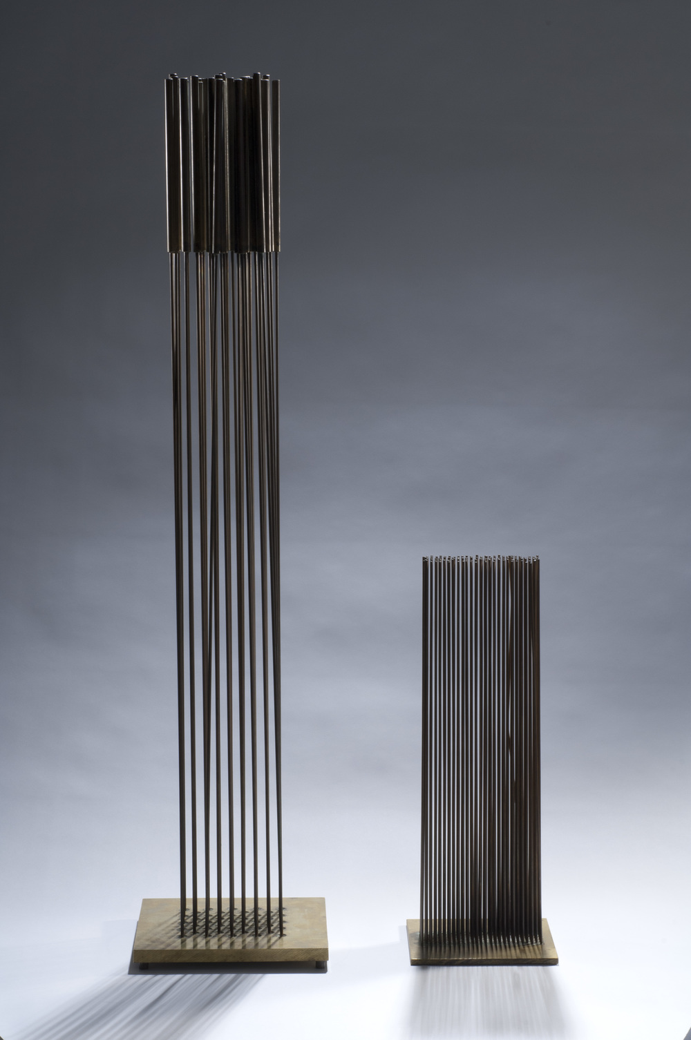 LEFT:  SOLD    Sonambient, c. 1960s  , copper on bronze, 36 3/4 x 7 3/4 x 7 3/4 inches  RIGHT:   Sonambient (Eleven Rows)  , Beryllium copper and brass, 16 x 2 x 5 inches