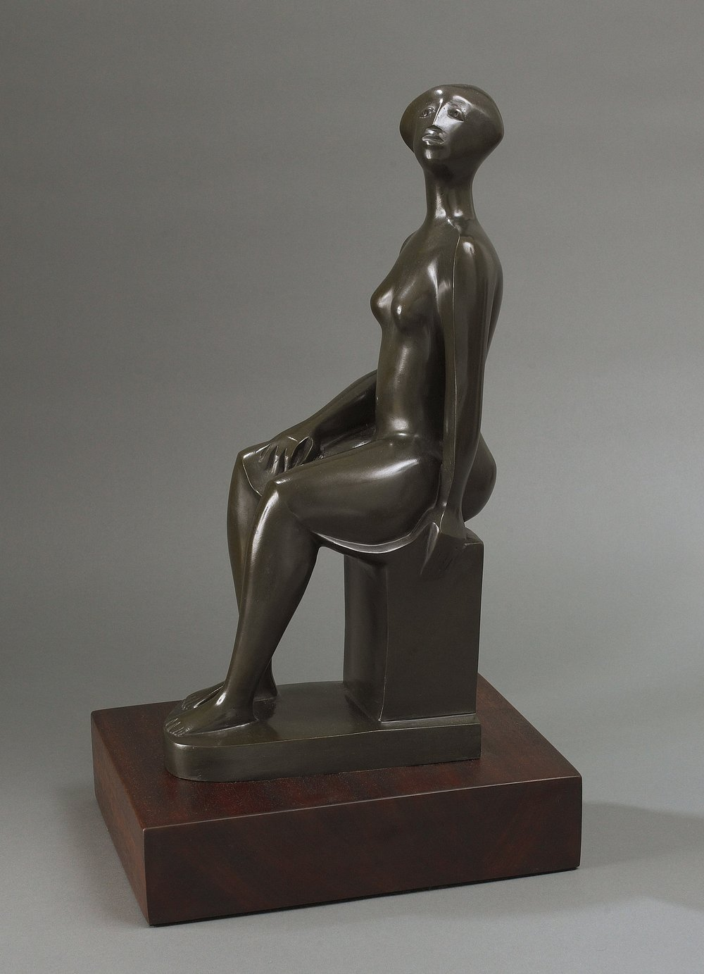 Mujer Sentada, c. 2003, bronze sculpture, 17 1/2 x 6 x 9 inches, signed with monogram