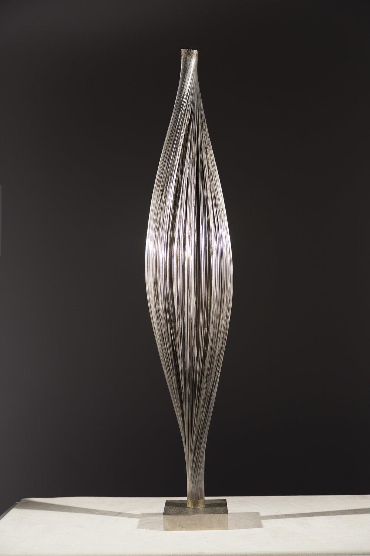 Untitled (Wire Bundle),c. 1967, steel wire, bronze, silver solder,30 1/4 x 5 1/2 diameter inches