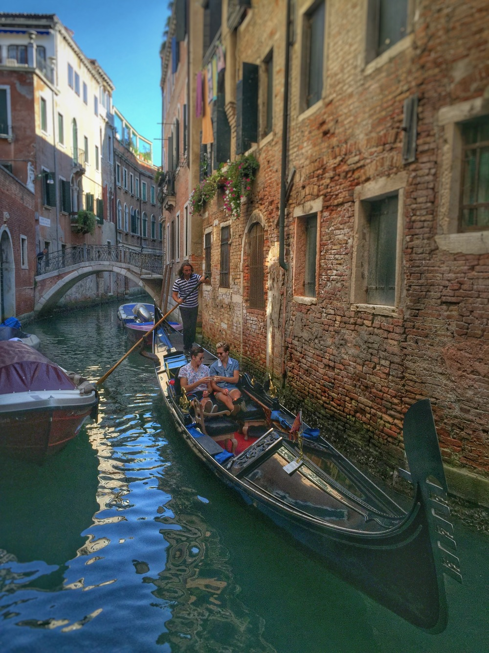 This photo was taken by a random tourist during our gondola ride. We recognized her at a cafe later that day and asked her to send it to us!