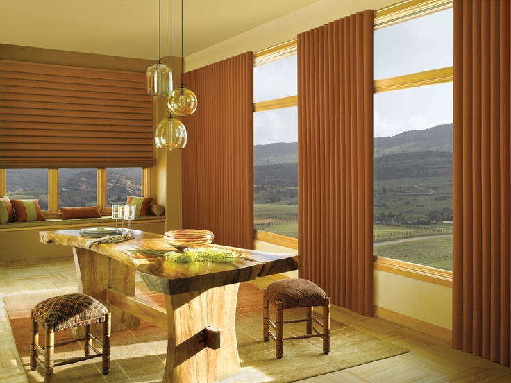 VIGNETTE TRAVERSED VERTICAL SHADES   The Vignette Traversed window blind offers you a smooth and seamless look. These shades, which come in many different options, can help add a very bold and clean style to your home or office. Click on the photo above to learn more.