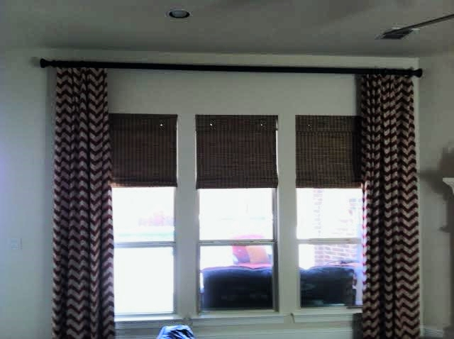 CUSTOM DRAPERY PANELS WITH WOVEN WOOD SHADES IN PLANO, TX