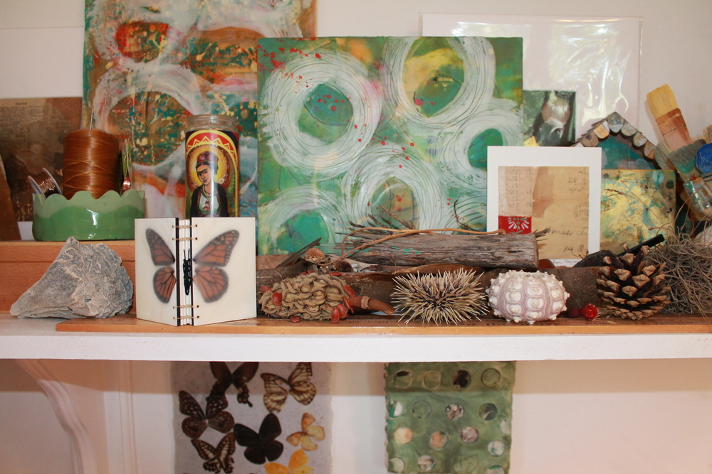 That beautiful hand-bound butterfly journal is by artist  Erin Keane