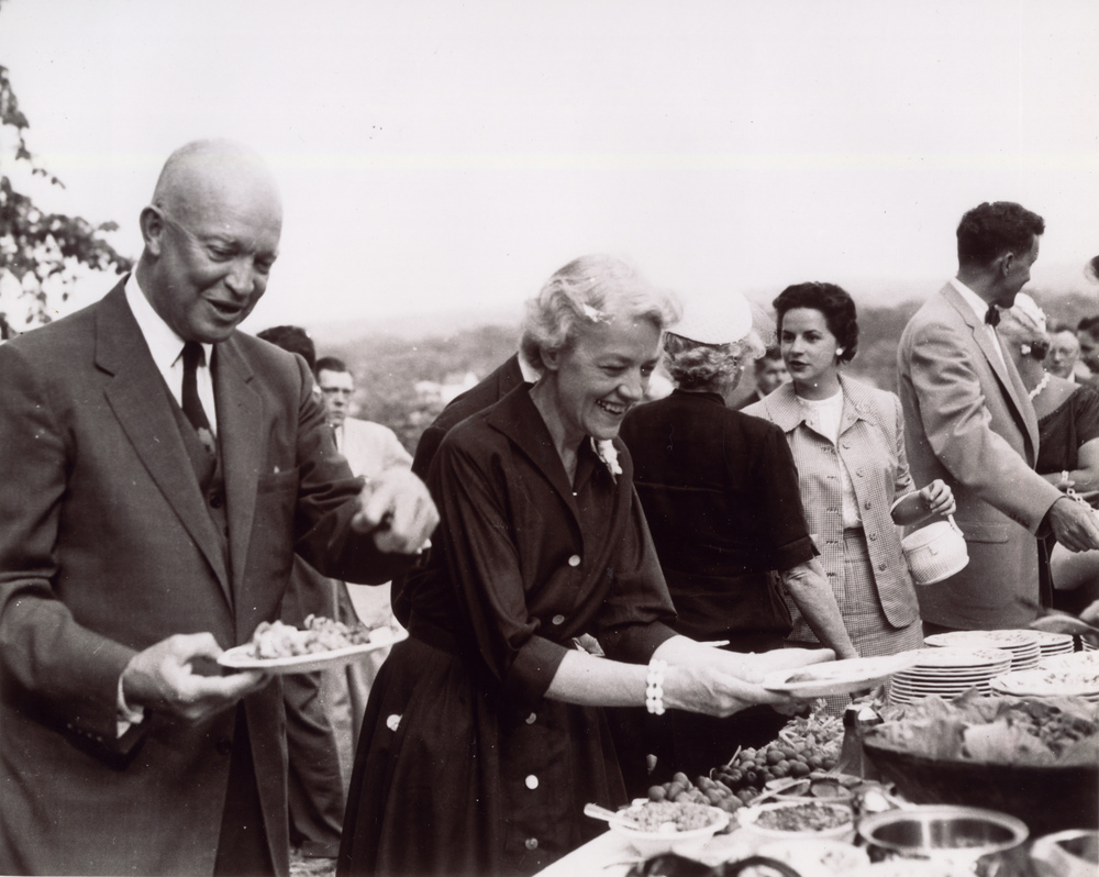 1955: Hosts President Dwight D. Eisenhower at her home during his visit to Skowhegan, Maine.
