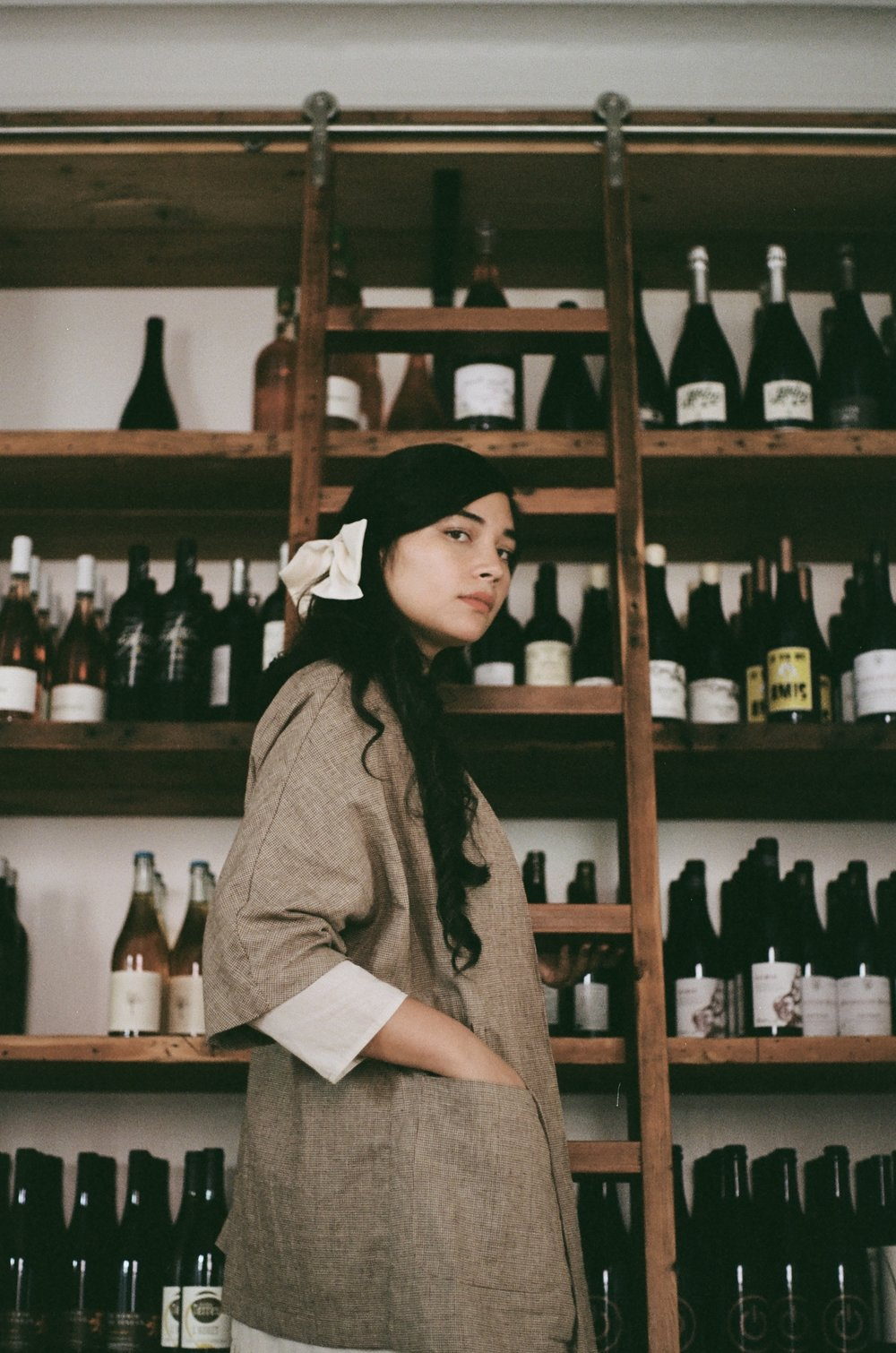 Lane wearing her Ruth jacket from SS18, in the wine storage room of her new offices adjacent to Fadensonnen.