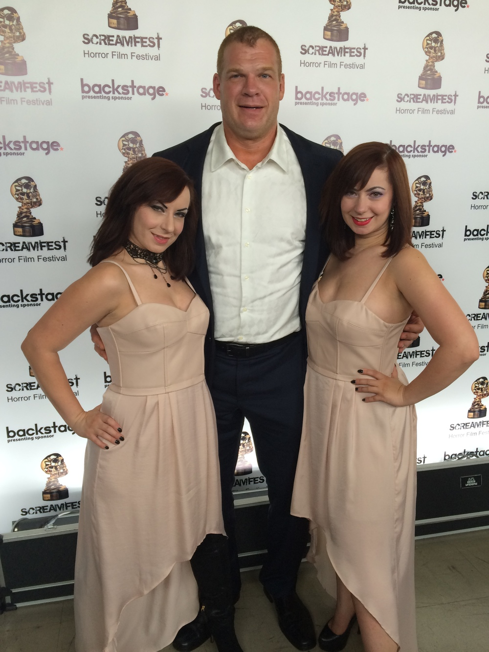"Directors Jen and Sylvia Soska with WWE Superstar Glenn ""Kane"" Jacobs at the 2014 Screamfest premiere of the WWE Studios / Lionsgate film 'See No Evil 2.'"