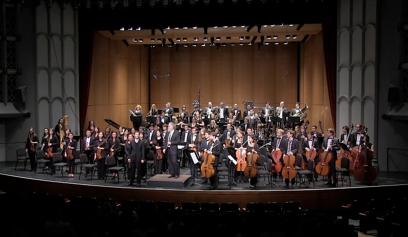 Daniel takes a bow after the premiere of From Distant Dreams by the Thornton Symphony Orchestra and Donald Crockett in October 2014.