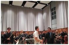 Dan (L), Vinay Parameswaran (R), and the Curtis Symphony Orchestra