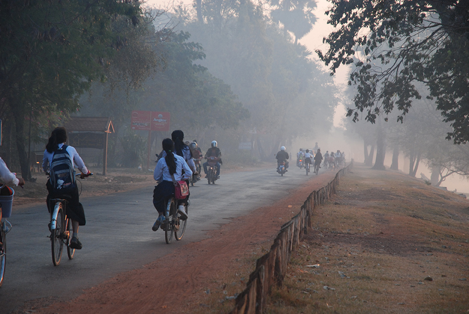 Cambodia's Angkor City. A morning commute for modern students along an ancient waterway