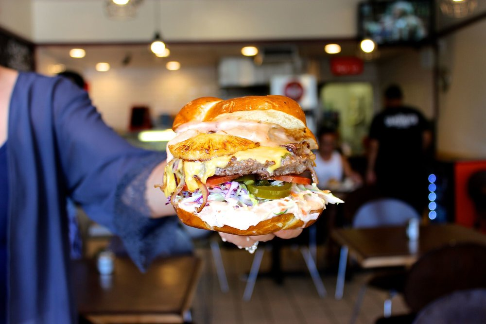 Co-Owner Mi Ho shows off one of Sandwich Society's popular items | photo courtesy of 100eats