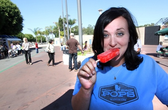 Front Porch Pops owner Erin enjoys one of her handmade frozen treats | photo courtesy of OC Weekly