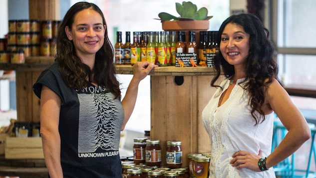 Delilah Snell (left) showcasing a display of local Mexican products | photo courtesy of Paste Magazine