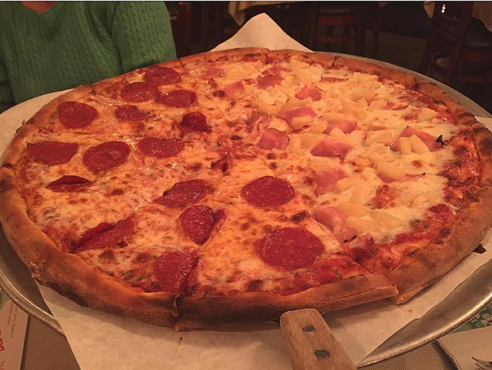 Pizzeria La Piccola's Pepperoni Pizza paired with Hawaiian | Photo courtesy of Brenda Mars via Instagram