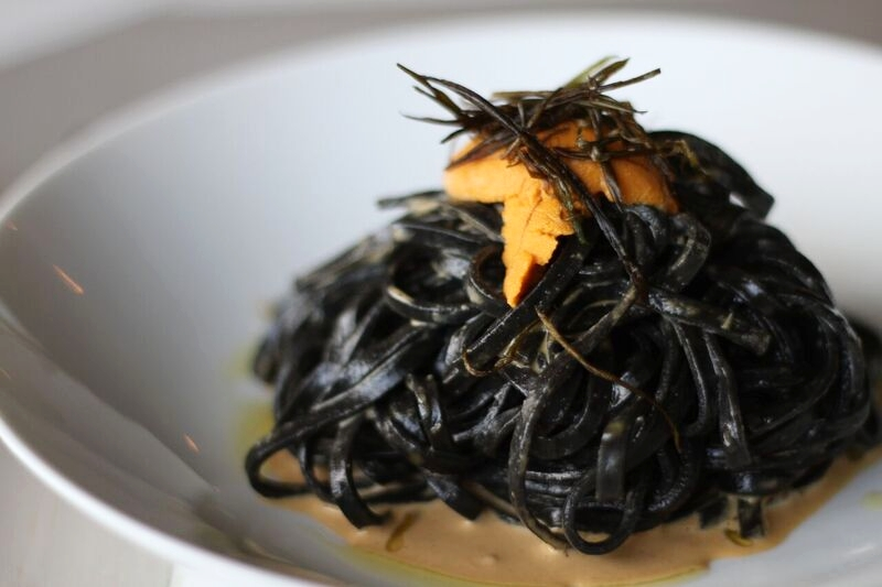 Shuck Oyster Bar's Uni Pasta with uni beurre blanc and squid ink pasta.