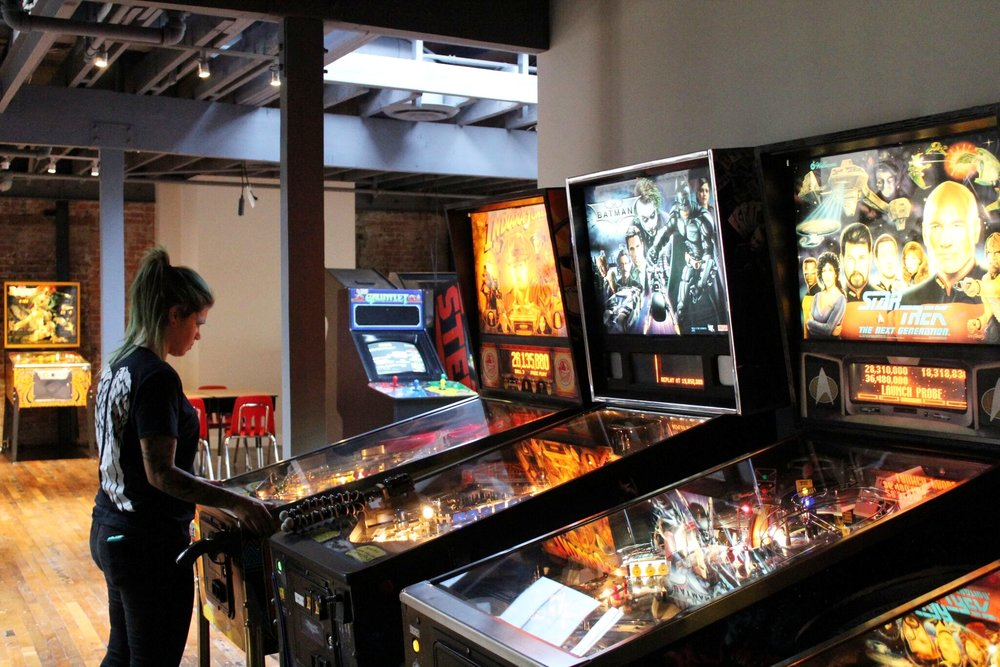 McFadden Public Market's upstairs bar, Mission Control boasts over a dozen vintage arcade games, such as pinball and more | photo courtesy of 100eats
