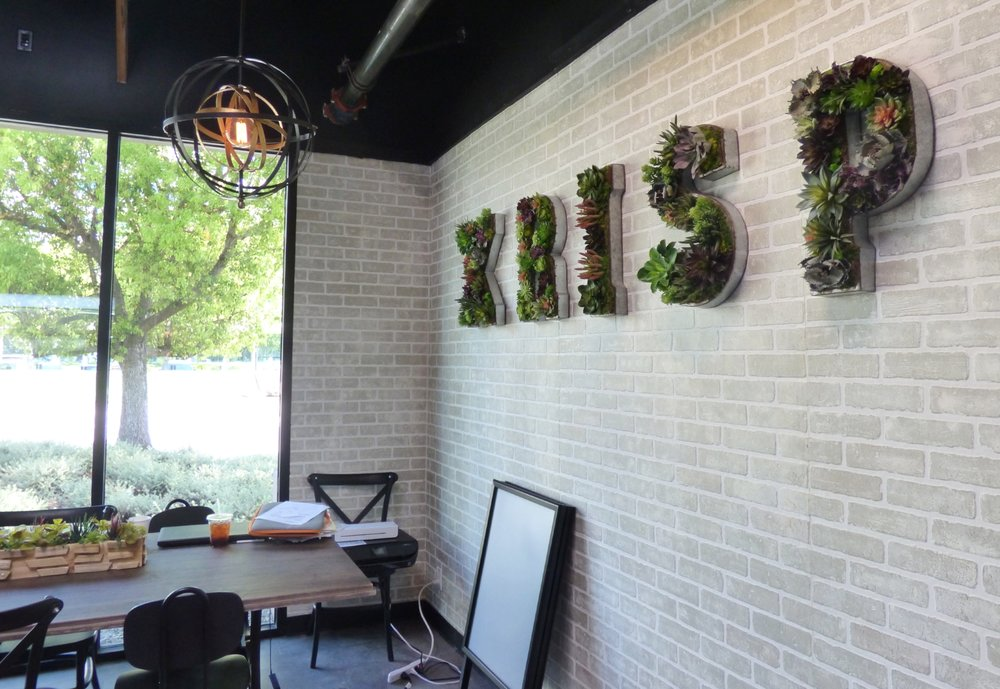 KRISP's light and bright interior welcomes you to sit and stay a while | photo courtesy of 100eats