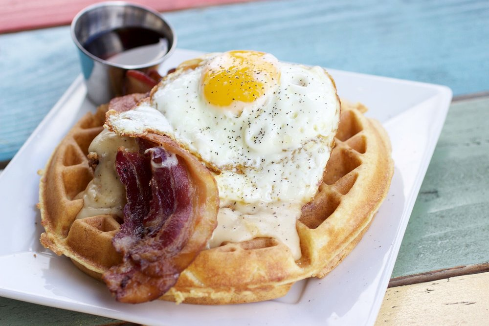 Because everyone loves beer...and waffles! Let Dad indulge in this Country Breakfast, complete with fried chicken, bacon and house made gravy at The Iron Press | photo courtesy of 100eats