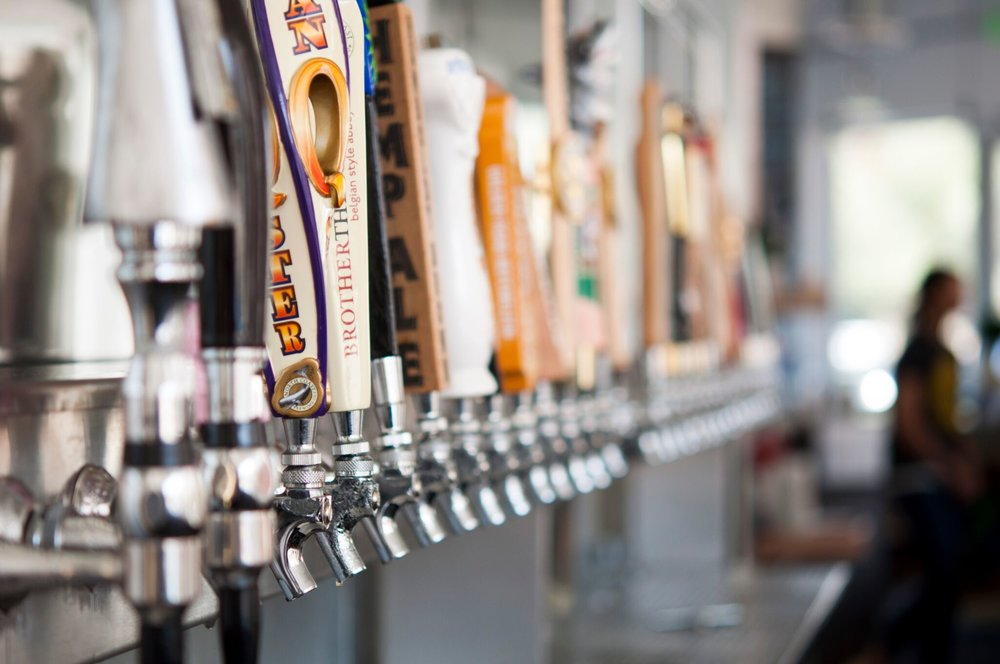 Select from 30 taps of rotating craft beer at The Iron Press | photo courtesy of 100eats