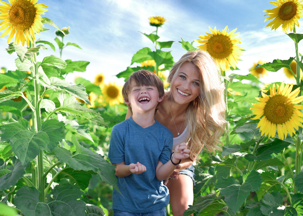 kids and family sunflower blue sky.jpg