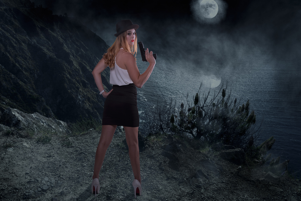 woman with gun on a foggy night fog moon sea seashore surreal moon clouds dark cool.jpg