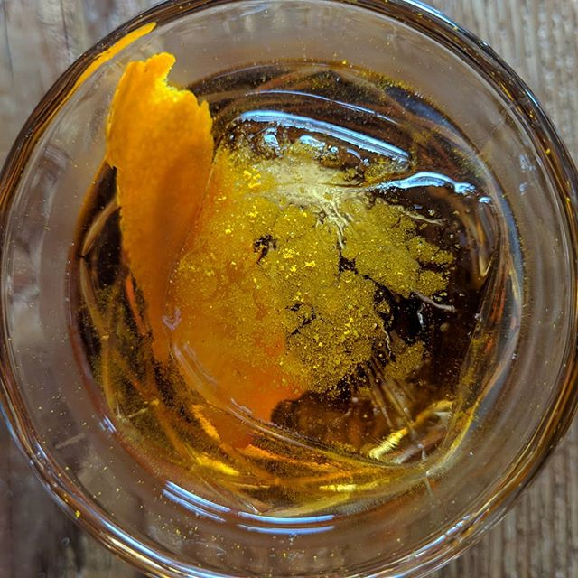Indian food inspired Negroni riff: 1.5 oz Beefeater gin, .75 oz Gran Classico orange bitter liqueuer, .75 oz Carpano Antica sweet vermouth, 2 dashes Scrappy's cardamom bitters, garnished with orange zest and pinch of turmeric powder. #negroniweek