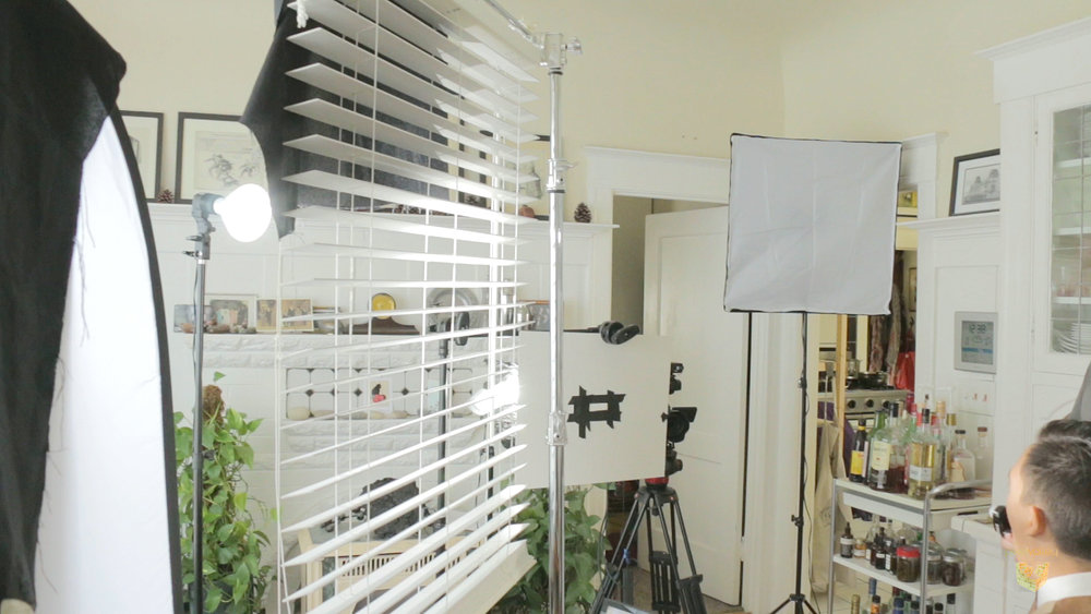 A venetian blind is rigged in front of the key to create shadows on talent and background, a type of cucoloris.