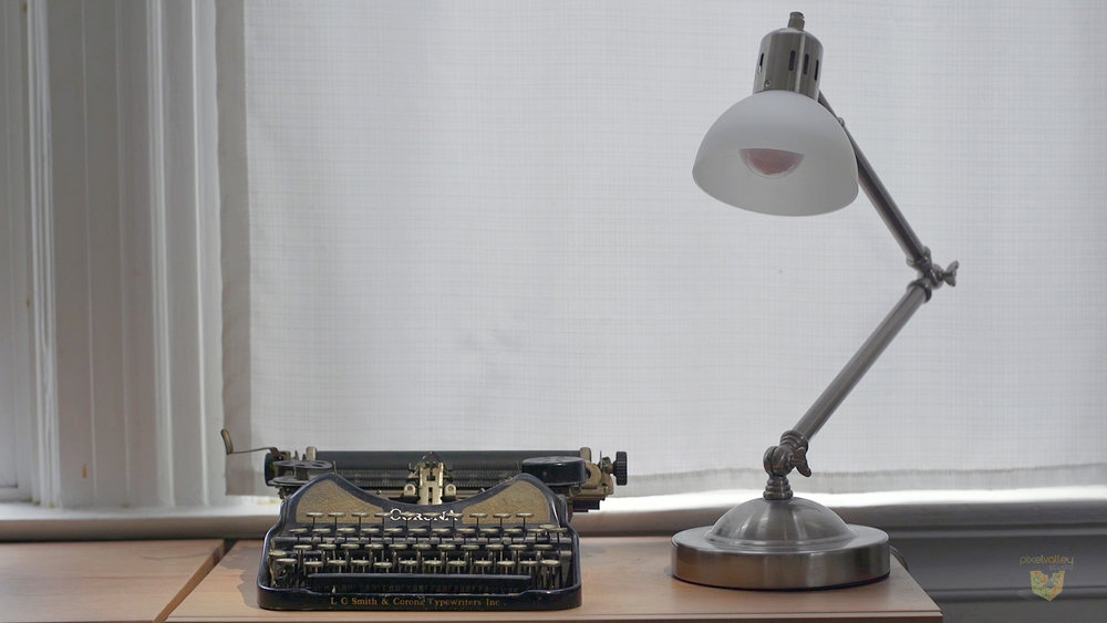 After: Spot of light on the typewriter draws focus to it.