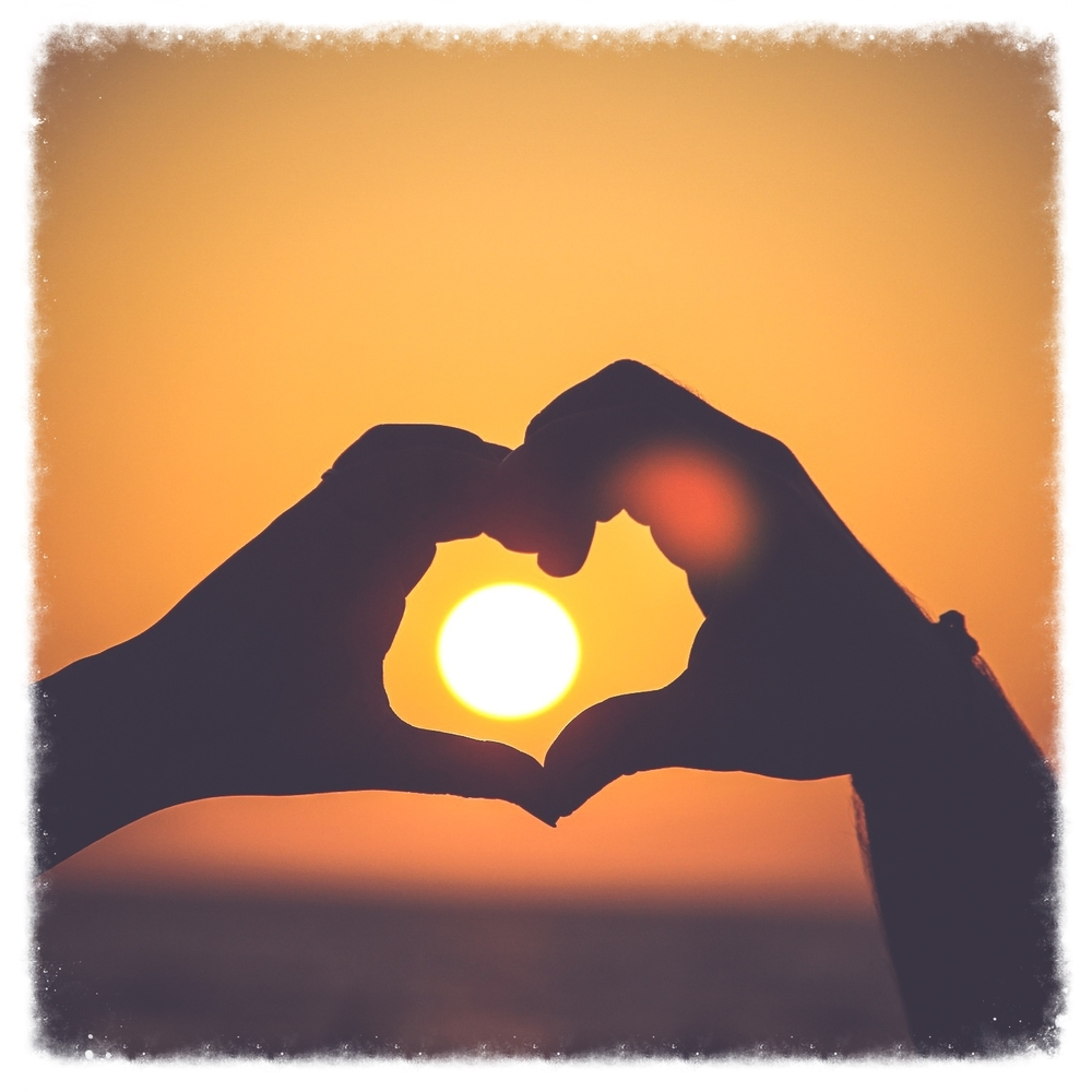 heart hands sunset.stocksnap.io.jpg